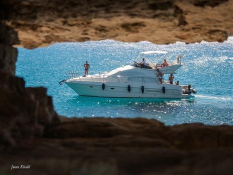 Cape Greco - Passing boat