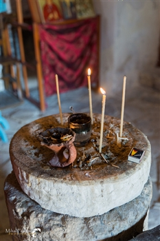 Light a candle at Timou Monastry