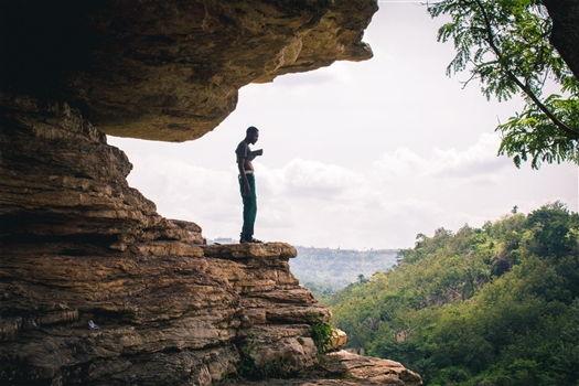 Man on boulder
